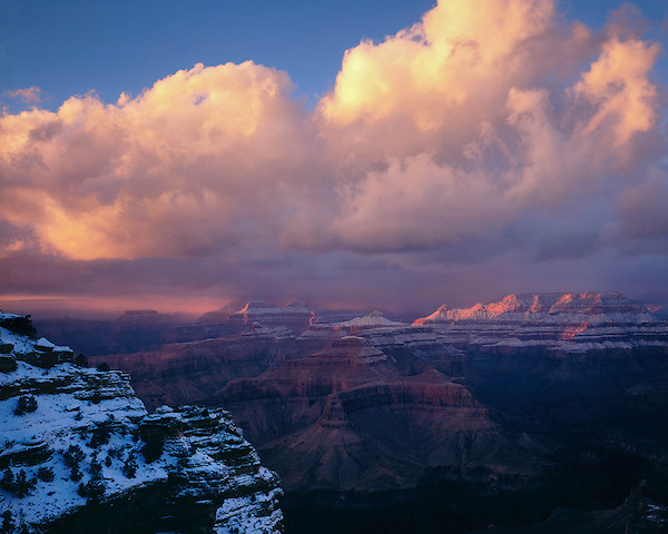 Sunburst during a winter snowstorm along the South Rim of Grand Canyon National Park, northern Arizona, USA .  John offers private photo tours in Grand Canyon National Park and throughout Arizona, Utah and Colorado. Year-round.