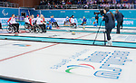 Sochi, RUSSIA - Mar 10 2014 -  Jim Armstrong takes a shot during Canada vs USA in Wheelchair Curling round robin play at the 2014 Paralympic Winter Games in Sochi, Russia.  (Photo: Matthew Murnaghan/Canadian Paralympic Committee)