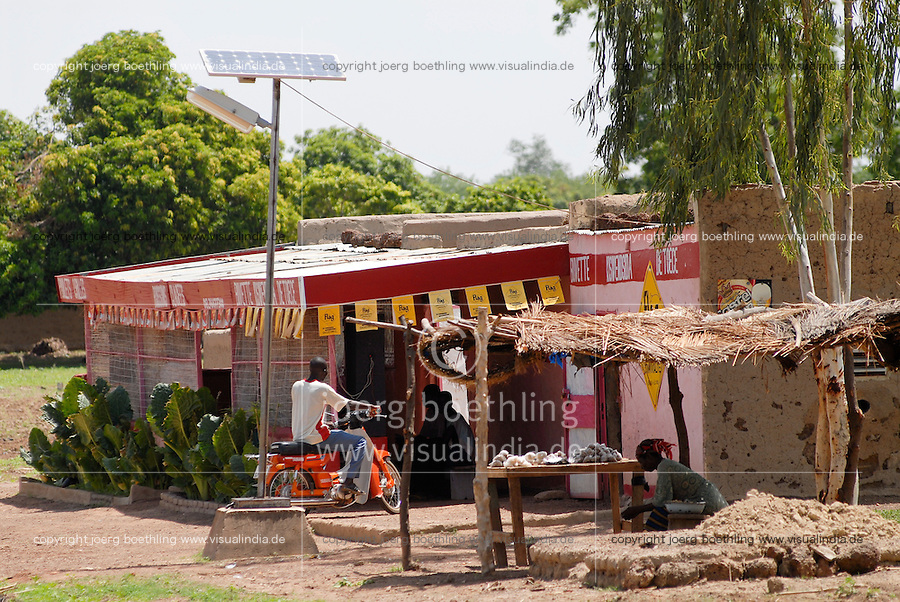 "Afrika Westafrika Burkina Faso .Haus und Laterne mit Photovoltaik Anlage  -  Energie erneuerbare Afrikaner afrikanisch xagndaz | .Africa west-africa Burkina Faso.village house  -   .| [ copyright (c) Joerg Boethling / agenda , Veroeffentlichung nur gegen Honorar und Belegexemplar an / publication only with royalties and copy to:  agenda PG   Rothestr. 66   Germany D-22765 Hamburg   ph. ++49 40 391 907 14   e-mail: boethling@agenda-fototext.de   www.agenda-fototext.de   Bank: Hamburger Sparkasse  BLZ 200 505 50  Kto. 1281 120 178   IBAN: DE96 2005 0550 1281 1201 78   BIC: ""HASPDEHH"" ,  WEITERE MOTIVE ZU DIESEM THEMA SIND VORHANDEN!! MORE PICTURES ON THIS SUBJECT AVAILABLE!! ] [#0,26,121#]"