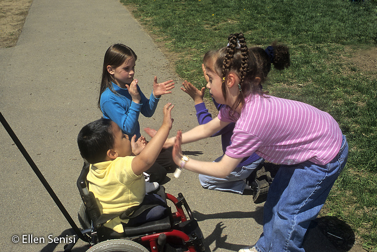 MR / Schenectady, New York. Zoller Public School / Grade 1 Inclusion Class. Recess: students play hand game outside. Boy in wheelchair: 7, spina bifida, sacral agenesis, Bangledeshi & Puerto Rican-American. MR: SNB PN#:30005 FC#:21651-01009 scan from slide ©Ellen B. Senisi
