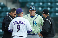Wilmington Blue Rocks manager Scott Thorman (9) meets at home plate with Winston-Salem Dash manager Justin Jirschele (9) and umpires Raul Moreno (left) and Steven Hodgins (right) prior to their Carolina League game at BB&T Ballpark on April 15, 2019 in Winston-Salem, North Carolina. The Dash defeated the Blue Rocks 9-8. (Brian Westerholt/Four Seam Images)