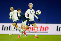 LE HAVRE, FRANCE - APRIL 13: Megan Rapinoe #15 of the United States moves with the ball during a game between France and USWNT at Stade Oceane on April 13, 2021 in Le Havre, France.
