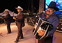 """voz-FoodCityFiestas0919 091407 Members of the group """"Los Originales Cadetes de Linares"""" (cq) performed at the Food City Fiestas Patrias in Phoenix, on Friday, Sept. 14, 2007.  Photo by AJ Alexander/La Voz"""