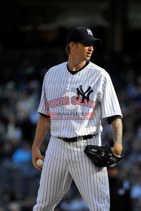 Apr 02, 2011; Bronx, NY, USA; New York Yankees pitcher A.J. Burnett (34) during game against the Detroit Tigers at Yankee Stadium. Yankees defeated the Tigers 10-6. Mandatory Credit: Tomasso De Rosa