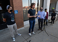 Siera Delk (from left), The Rev. Clint Schnekloth, Walt Kelly, Blake Worthey and Patricia Rodriguez speak Thursday, Nov. 19, 2020, during a press conference outside the Fayetteville city administration building. The Arkansas Justice Collective, a nonprofit advocacy group, released a report last year detailing misdemeanor marijuana arrests made by the city's police and released a follow-up report Thursday. Visit nwaonline.com/201120Daily/ for today's photo gallery.