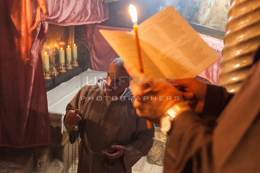 A friars celebrate and sings in Latin  in the Nativity's Grotto, Bethlehem