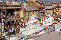 Bodhnath, Nepal.  View of Buildings Surrounding the Stupa.  Tamang Gompa on Left.  Prayer Flags.