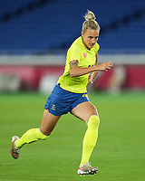 YOKOHAMA, JAPAN - AUGUST 6: Nathalie Bjorn #14 of Sweden goes forward during a game between Canada and Sweden at International Stadium Yokohama on August 6, 2021 in Yokohama, Japan.