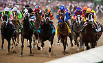 Louisville, KY- May 04:  Eventual winner, Believe You Can with Rosie Napravnik up (center, orange and green) leads the field for the Kentucky Oaks at Churchill Downs in Louisville, KY on 05/04/12. (Alex Evers/ Eclipse Sportswire)