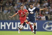 MELBOURNE, AUSTRALIA - OCTOBER 30: Surat Sukha of the Victory protects the ball from Fabian Barbiero of United during the round 12 A-League match between the Melbourne Victory and Adelaide United at Etihad Stadium on October 30, 2010 in Melbourne, Australia.  (Photo by Sydney Low / Asterisk Images)