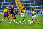 Kerry's Kayleigh Cronin gets her effort away as Shauns Murphy of Wexford attempts to block her effort, in the Lidl LGFA National football league game in Fitzgerald Stadium Killarney on Sunday.
