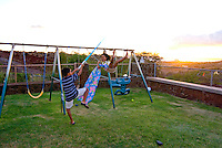 Local children playing in yard at home, Makakilo, Oahu