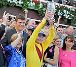 5 September 2009:Rachel Alexandra jockey Calvin Borel holds up the winner's trophy for the Woodward Stakes at Saratoga Race Track in Saratoga Springs, New York
