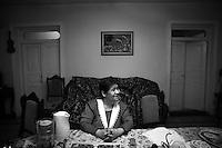 "Nagorny-Karabach, 09.05.2011, Shushi. Eine Bewohnerin Schuschis sitzt am Tisch ihres Wohnzimmers. ""The Twentieth Spring"" - ein Portrait der s¸dkaukasischen Stadt Schuschi, 20 Jahre nach der Eroberung der Stadt durch armenische K?mpfer 1992 im B¸gerkrieg um die Unabh?ngigkeit Nagorny-Karabachs (1991-1994). An armenian Lady sits at a table in her living room. ""The Twentieth Spring"" - A portrait of Shushi, a south caucasian town 20 years after its ""Liberation"" by armenian fighters during the civil war for independence of Nagorny-Karabakh (1991-1994)..Une dame arménienne est assise à  table dans son salon.""Le Vingtieme Anniversaire"" - Un portrait de Chouchi, une ville du Caucase du Sud 20 ans après sa «libération» par les combattants arméniens pendant la guerre civile pour l'indépendance du Haut-Karabakh (1991-1994)..© Timo Vogt/Est&Ost, NO MODEL RELEASE !!"