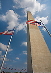 Washington, DC<br /> Washington monument (1884) a 555 ft. obelisk with American flags surrounding the base