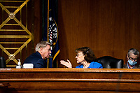 "United States Senator Lindsey Graham (Republican of South  Carolina), Chairman, US Senate Judiciary Committee, left, confers with US Senator Dianne Feinstein (Democrat of California), Ranking Member, US Senate Judiciary Committee, right, during a US Senate Judiciary Committee Hearing ""to examine COVID-19 fraud, focusing on law enforcement's response to those exploiting the pandemic"" on Capitol Hill in Washington, DC on June 9, 2020. <br /> Credit: Erin Schaff / Pool via CNP/AdMedia"