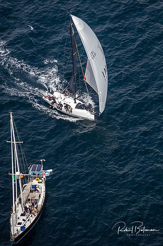 Michael and Richard Evans J99 Snapshot from Howth crosses the finish line under spinnaker on day two of the Sovereigns Cup in Kinsale. Photo: Bob Bateman