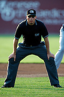 Umpire Sam Vogt during a game between the Batavia Muckdogs and Connecticut Tigers at Dwyer Stadium on July 6, 2012 in Batavia, New York.  Batavia defeated Connecticut 3-2.  (Mike Janes/Four Seam Images)