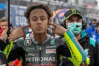 29th August 2021; Silverstone Circuit, Silverstone, Northamptonshire, England; MotoGP British Grand Prix, Race Day; Petronas Yamaha SRT rider Franco Valentino Rossi puts his earplugs in his ears