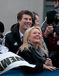 Swansea manager Michael Laudrup with his wife Siw and Swansea City Football team celebrating during an open-top bus parade through the centre of Swansea after beating Bradford City 5-0 in Sunday's Capital One Cup final at Wembley to win the Capital Cup trophy.