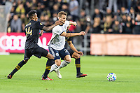 LOS ANGELES, CA - MARCH 08: Kacper Przybylko #23 of Philadelphia and Mark-Anthony Kaye #14 of LAFC battle for the ball during a game between Philadelphia Union and Los Angeles FC at Banc of California Stadium on March 08, 2020 in Los Angeles, California.