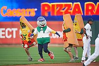 Cedar Rapids Kernels mascot Mr. Shucks on the field for an in game pizza race promotion during the first game of a doubleheader against the Kane County Cougars on May 10, 2016 at Perfect Game Field in Cedar Rapids, Iowa.  Kane County defeated Cedar Rapids 2-0.  (Mike Janes/Four Seam Images)