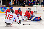Sochi, RUSSIA - Mar 11 2014 -  Greg Westlake takes a shot on a the Czech goalie as Canada takes on Czech Republic in Sledge Hockey at the 2014 Paralympic Winter Games in Sochi, Russia.  (Photo: Matthew Murnaghan/Canadian Paralympic Committee)