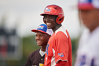 Juan Martinez (7) and Breiner Pena (black jersey) during the Dominican Prospect League Elite Florida Event at Pompano Beach Baseball Park on October 15, 2019 in Pompano beach, Florida.  (Mike Janes/Four Seam Images)