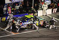 Feb 07, 2009; Daytona Beach, FL, USA; NASCAR Sprint Cup Series driver Jimmie Johnson pits during the Bud Shootout at Daytona International Speedway. Mandatory Credit: Mark J. Rebilas-
