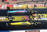 Apr. 1, 2011; Las Vegas, NV, USA: NHRA top fuel dragster driver Mike Strasburg (top) races alongside Spencer Massey during qualifying for the Summitracing.com Nationals at The Strip in Las Vegas. Mandatory Credit: Mark J. Rebilas-