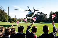 President Trump Travels to IA<br /> <br /> Marine One carrying President Donald J. Trump lifts off from the South Lawn the White House Wednesday, Oct. 14, 2020, en route to Joint Base Andrews, Md. to begin his trip to Des Moines, Iowa. (Official White House Photo by Tia Dufour)