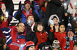 Fresno State fans shine their phone lights during the second half of an NCAA college football game in Reno, Nev., on Saturday, Nov. 22, 2014. Fresno State defeated Nevada 40-20. (AP Photo/Cathleen Allison)
