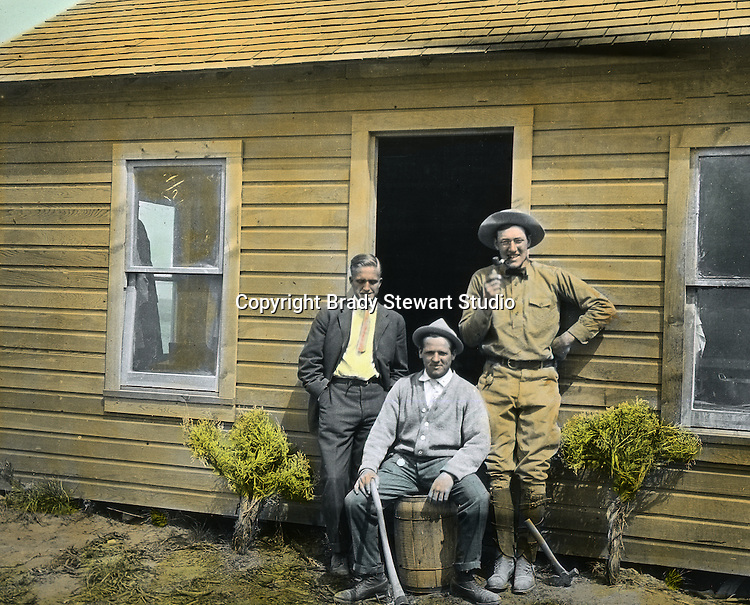 Jerome ID:  Tawney, Torrance, and friend from Pittsburgh posing in front of the homestead.  Brady Stewart and three friends went to Idaho on a lark from 1909 thru early 1912.  As part of the Mondell Homestead Act, they received a grant of 160 acres north of the Snake River.  Brady Stewart photographed the adventures of farming along with the spectacular landscapes. To give family and friends a better feel for the adventure, he hand-color black and white negatives into full-color 3x4 lantern slides.  The Process:  He contacted a negative with another negative to create a positive slide.  He then selected a fine brush and colors and meticulously created full-color slides.