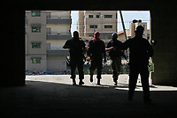 Militants escort Abu Obeida , a spokesman for Hamas's armed wing the Ezzedine Al-Qassam Brigades, as he arrives to hold a press conference in Gaza City on June 04, 2009.  four people were killed in a West Bank shoot-out on June 04 during an arrest operation for a senior Hamas militant, deepening the rift between the rival Palestinian factions. The Islamist Hamas movement ruling the Gaza Strip warned that the rival Fatah movement loyal to president Mahmud Abbas had crossed a 'red line' by carrying out the operation which killed two of its members.Militants escort Abu Obeida , a spokesman for Hamas's armed wing the Ezzedine Al-Qassam Brigades, as he arrives to hold a press conference in Gaza City on June 04, 2009.  four people were killed in a West Bank shoot-out on June 04 during an arrest operation for a senior Hamas militant, deepening the rift between the rival Palestinian factions. The Islamist Hamas movement ruling the Gaza Strip warned that the rival Fatah movement loyal to president Mahmud Abbas had crossed a 'red line' by carrying out the operation which killed two of its members.photo by Thaer alhasani/propaimages.