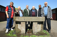 The committee of the Hackney & Leyton League pose for a photograph by the water trough in the dressing room block at East Marsh, Hackney Marshes, which is scheduled for demolition in early May 2010 - 18/04/10 - MANDATORY CREDIT: Gavin Ellis/TGSPHOTO - Self billing applies where appropriate - Tel: 0845 094 6026