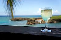 Glass of fresh white wine by tropical beach, Boca de Yuma, Dominican Republic