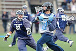 Baltimore- February 4: Ryan McGarvey of Penn State defends Greg Edmonds during the exhibition between Johns Hopkins and Penn State at Homewood Field on February 04, 2012 in Baltimore, MD.