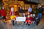 The Ballygarry House Hotel present a cheque for €820 to Enable Ireland (Kerry Branch) at the Ballygarry House Hotel on Friday. Kneeling l to r: Sean Scally (Enable Ireland Kerry Branch), Aoise Healy and Thomas, Rose, Karen and Katie O'Flaherty. Back l to r: Marie Galvin, Santa Clause, Padraig and Carmel McGillicuddy, Thys Vogel and Rimantas Romaska.