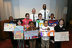WATERBURY, CT 01/03/08-010308BZ01- Connecticut Fire Prevention Poster Contest winners from Waterbury display their winning entries after a ceremony honoroing their work Thursday afternoon.<br /> Front row from left- Fourth graders Tiffany Deltoro, Moshay Morey, Steffany Sanchez (CQ), and Sunshine Drysdale<br /> Middle row from left- Fifth graders Shamar Venters, Shannice Rodriguez (CQ), Julianna McGuire, and Stanley Little<br /> Standing in back are Waterbury Fire Inspector Lt. Tom Varanelli and Inspector Corey Outlaw.<br /> <br /> <br /> Jamison C. Bazinet Republican-American