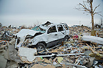 Wreck of car in town destroyed by tornado