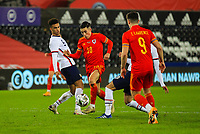 12th November 2020; Liberty Stadium, Swansea, Glamorgan, Wales; International Football Friendly; Wales versus United States of America; Harry Wilson of Wales skips past the challenge from Antonee Robinson of USA