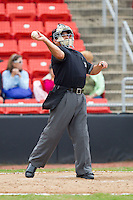Home plate umpire Jose Esteras throws a new baseball to the pitcher during a South Atlantic League game between the Kannapolis Intimidators and the Hickory Crawdads at  L.P. Frans Stadium August 1, 2010, in Hickory, North Carolina.  Photo by Brian Westerholt / Four Seam Images