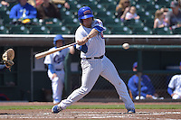 Taylor Davis (19) of the Iowa Cubs swings at pitch against the New Orleans Zephyrs at Principal Park on April 23, 2015 in Des Moines, Iowa.  The Zephyrs won 9-2.  (Dennis Hubbard/Four Seam Images)