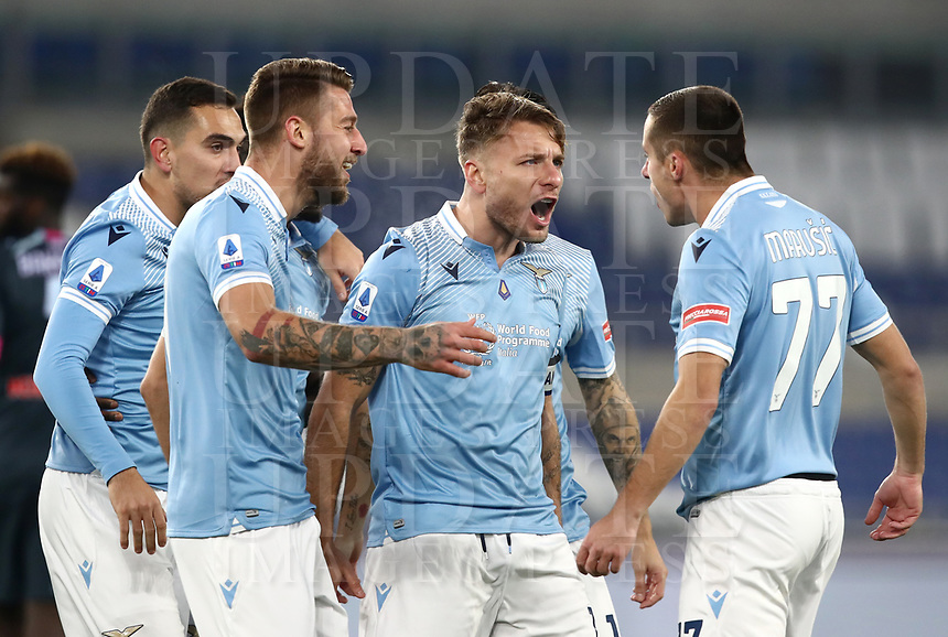 Calcio, Serie A: S.S.Lazio - Napoli, Olympic stadium, Rome, December 20, 2020. <br /> Lazio's  captain Ciro Immobile (second right) celebrates after scoring with his teammates during the Italian Serie A football match between Lazio and Napoli at the Olympic stadium, on December 20, 2020.<br /> UPDATE IMAGES PRESS/Isabella Bonotto
