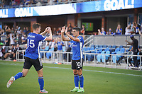 SAN JOSE, CA - JULY 24: Tanner Beason #15 of the San Jose Earthquakes celebrates a goal with teammate Cristian Espinoza #10 during a game between Houston Dynamo and San Jose Earthquakes at PayPal Park on July 24, 2021 in San Jose, California.