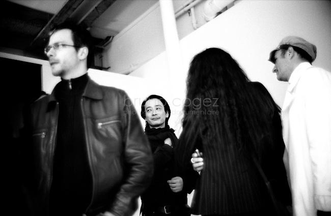 FRANCE, Paris, Le Laboratoire, Septembre 2008.Le Laboratoire présente pour la première fois en Europe, une exposition personnelle de l'artiste japonais Ryoji Ikeda, figure de la scène électronique sonore et visuelle. De ses échanges avec le mathématicien américain Benedict Gross, l'artiste inaugure une oeuvre où la définition du sublime s'accorde à l'immatérialité de l'infini. Portrait de Ryoji Ikeda parmi ses invités..FRANCE, Paris, Le Laboratoire, September 2011..Le Laboratoire presents, for the first time in Europe, a personal exhibition of the Japanese artist Ryoji Ikeda, a major figure of the sound and visual electronic scene. From his correspondence with the American mathematician Benedict Gross, he has conceived a work where the definition of the sublime blends with the immateriality of infinity. Portrait of Ryoji Ikeda..© Bruno Cogez