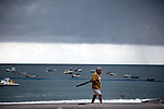 Holiday makers run for shelter as storm clouds close in on the township of Maiori on the Amafi Coast of Italy.