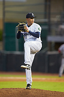 Pulaski Yankees relief pitcher Gilmael Troya (28) in action against the Greeneville Reds at Calfee Park on June 23, 2018 in Pulaski, Virginia. The Reds defeated the Yankees 6-5.  (Brian Westerholt/Four Seam Images)