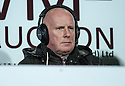Peter Houston who is believed to be one of the contenders for the vacant mangers position at Hearts manager takes his seat in the stand to commentate for Radio Scotland.