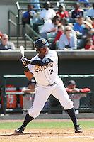 Charleston RiverDogs catcher Eduardo De Oleo #21 at bat during a game against the Greenville Drive at Joseph P. Riley Jr. Ballpark  on April 9, 2014 in Charleston, South Carolina. Greenville defeated Charleston 6-3. (Robert Gurganus/Four Seam Images)
